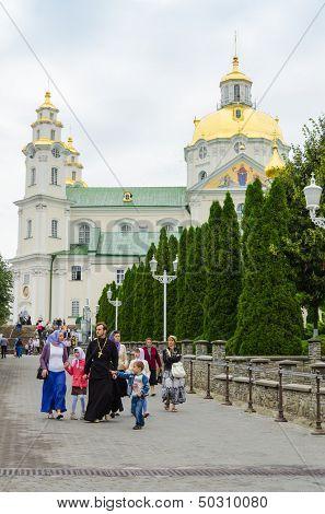 POCHAYIV, UKRAINE - AUGUST 14: Unidentified orthodox priest with family in Holy Dormition Pochayiv Lavra, Pochayiv, Ukraine on August 14, 2013