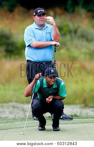 NORTON, MA-SEP 1: Tiger Woods (bottom) reads the green as Kevin Stadler stands during the third round at the Deutsche Bank Championship at TPC Boston on September 1, 2013 in Norton, Massachusetts.