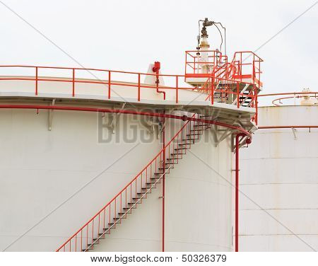 Oil Tank With Vivid Color Pipe And Staircase On White Background