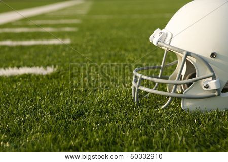 American Football Helmet on the Field with room for copy poster