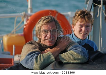 Father And Son Aboard Boat