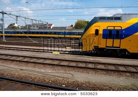 Trains at the railway remittance in Holland poster