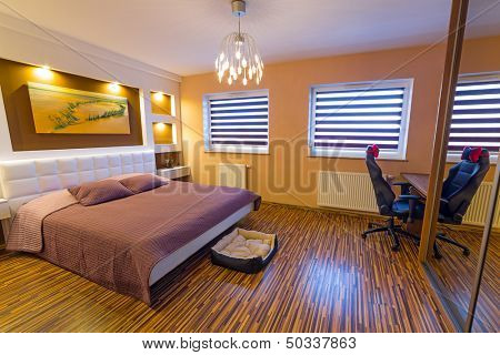 Modern master bedroom interior with picture of shipwreck on the wall (photo is coming from my gallery)