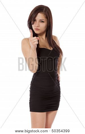 Young Woman In A Little Black Dress Points With Anger.