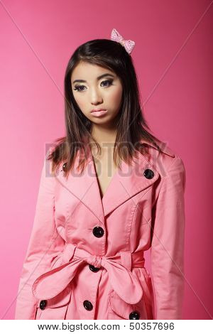 Stylish Japanese Girl In Pink Outwear Over Colored Background