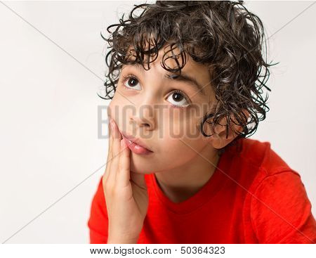 Young Boy Thinking with Sadness