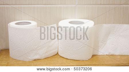 The Unwound Rolls Of White Toilet Paper