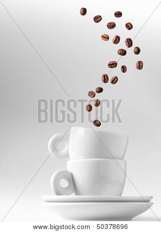 Double Espresso Metaphor With Coffee Beans Stream As A Smoke Over Two Small Caps