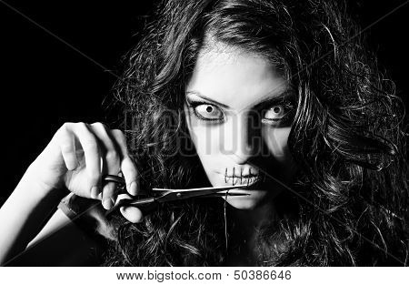 Horror Shot: Scary Strange Girl With Mouth Sewn Shut Cutting Off The Thread