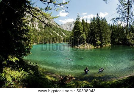 Scuba Divers And Green Lake