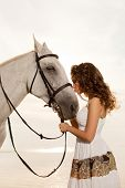 Beautiful woman on a horse. Horseback rider, woman riding horse on beach. poster