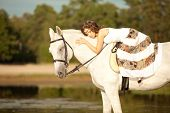 Young woman on a horse. Horseback rider, woman riding horse on beach. poster
