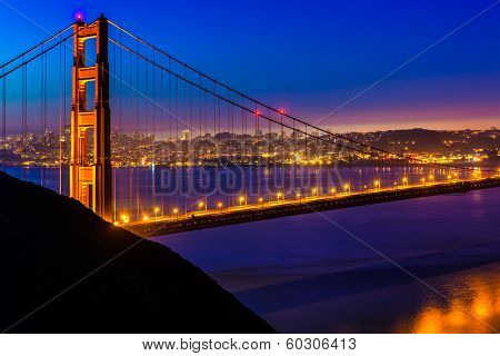 San Francisco Golden Gate Bridge sunset view through cables in California USA