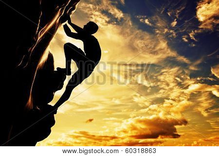 A silhouette of man free climbing on rock, mountain at sunset. Adrenaline, bravery, leader. poster