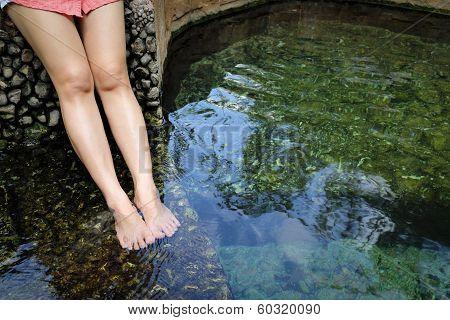 Women Legs Enjoys With Hot Springs Water