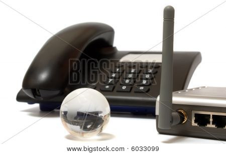 Office Phone, Wi-fi Router And Glass Globe