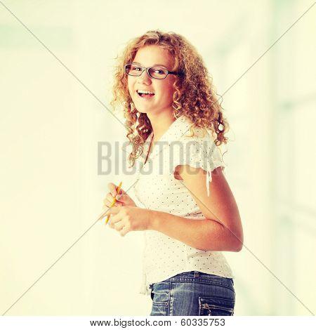 Beautiful corpulent caucasian student girl isolated on white background