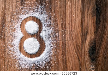 Shape of eight on wooden background.