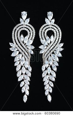 Silver earrings with jewels on the black