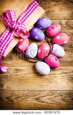 Painted Easter Eggs On Wooden Background.