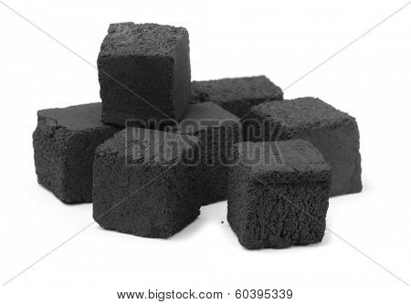 Group of charcoal cubes isolated on white