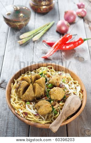 Mee bakso. Bakso or baso is Indonesian meatball  made from beef surimi. Popular local food in Indonesia.  Fresh hot with steam smoke. poster