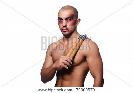 Man with nunchucks isolated on white