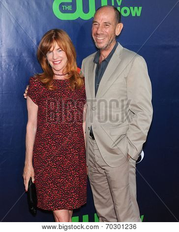 LOS ANGELES - JUL 17:  Miguel Ferrer & Lori Weintraub arrives to the CBS-CW-Showtime Summer TCA Press Tour 2014  on July7, 2014 in West Hollywood, CA.