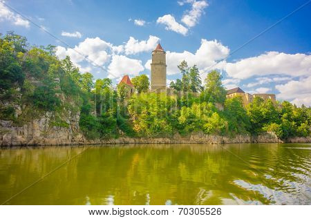 Medieval castle Zvikov in the Czech Republic with round tower, draw-bridge and blue sky seen from the river Vltava