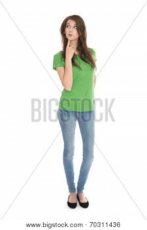 Slim Young Woman Wearing Green Shirt And Blue Jeans In Full Body Length Looking Pensive And Amused U