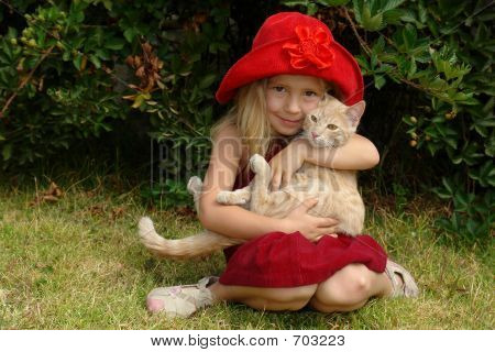 poster of the girl in red hat with a cat