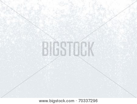 Glittering winter background. White sparkling texture with snowflakes.