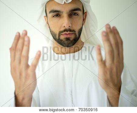 Arabic Muslim young man praying