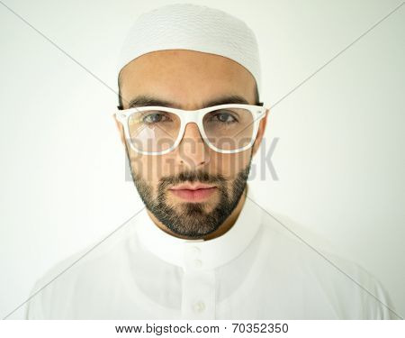 Arabic young businessman with glasses posing