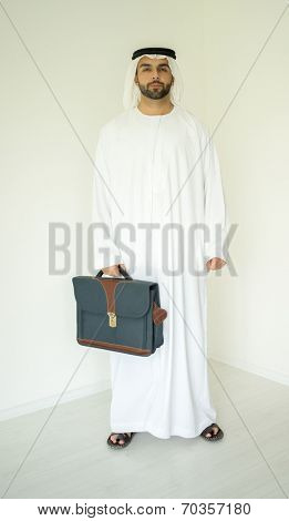 Arabic young businessman posing with bag