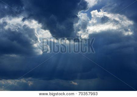 Sun beams coming through clouds poster