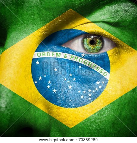 Brazillian Flag Painted On A Man's Face