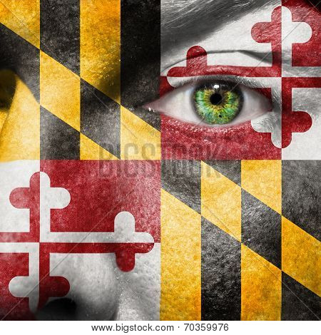 Flag Painted On Face With Green Eye To Show Maryland Support