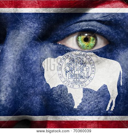 Flag Painted On Face With Green Eye To Show Wyoming Support