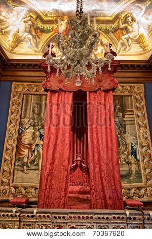 HAMPTON COURT, UK - AUGUST 03, 2014 - Baroque bed at state bedchamber at Hampton Court Palace near Londn on August 03, 2014