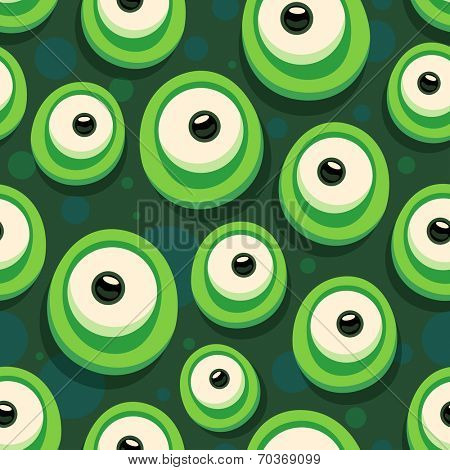 Seamless background with cartoon eyes of green monster