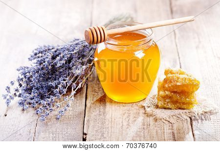 Jar Of Honey With Honeycomb And Lavander Flowers