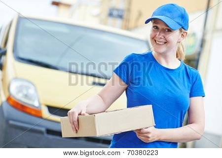 Smiling female postal delivery courier woman outdoors  in front of cargo van delivering package poster