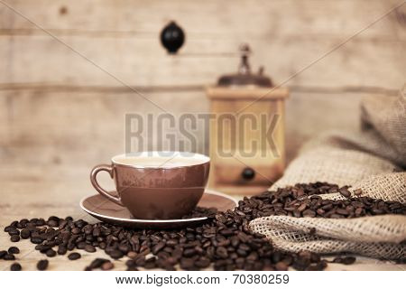 Old Aged Still Life On Coffee Beans, Cup And Coffee Grinder