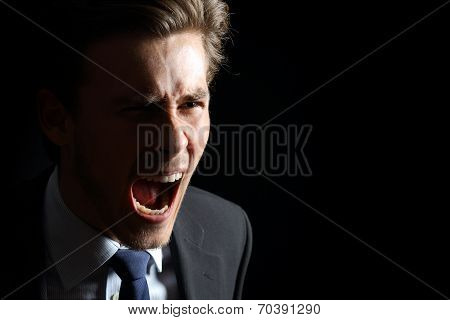 Angry Businessman Shouting Isolated In Black