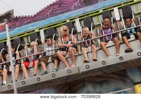 People On Carnival Ride At State Fair