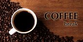 cup of black coffee and roasted coffe beans close-up with title coffee break poster
