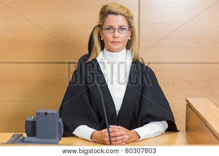 Stern judge looking at camera in the court room