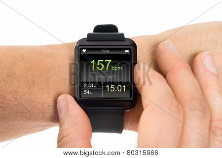 Human Hand With Smartwatch Showing Heartbeat Rate