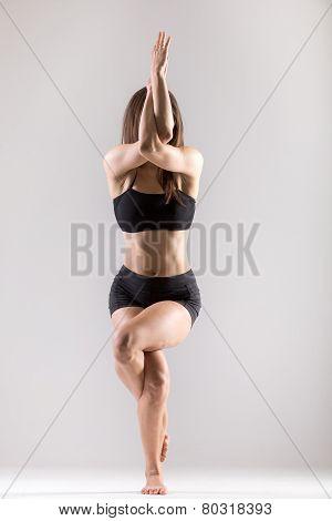 Yogi Gymnast Girl Doing Asana Garudasana, Eagle Pose